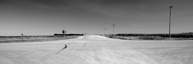 empty crossroads in an open prairie setting