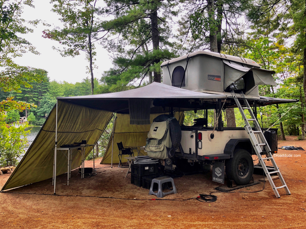 Adventure trailer with awning and rooftop tent.