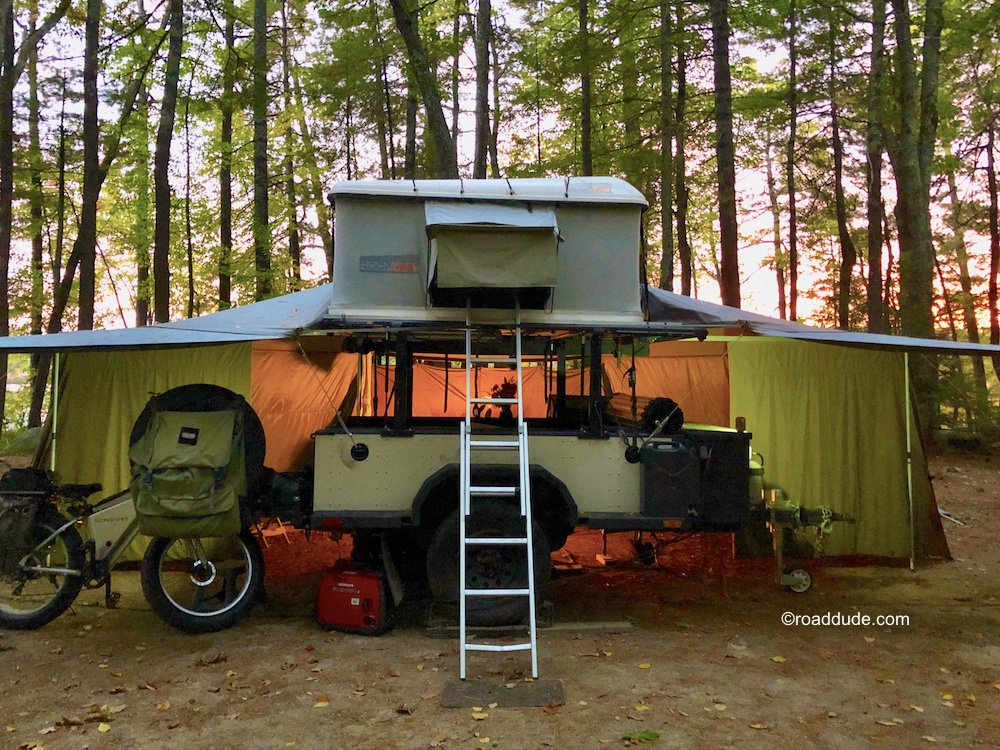 Adventure trailer set up for cold weather with awning and rooftop tent