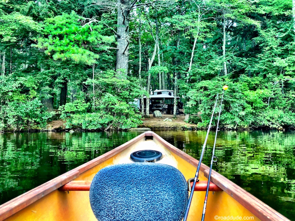 camp as seen from a canoe on a lake