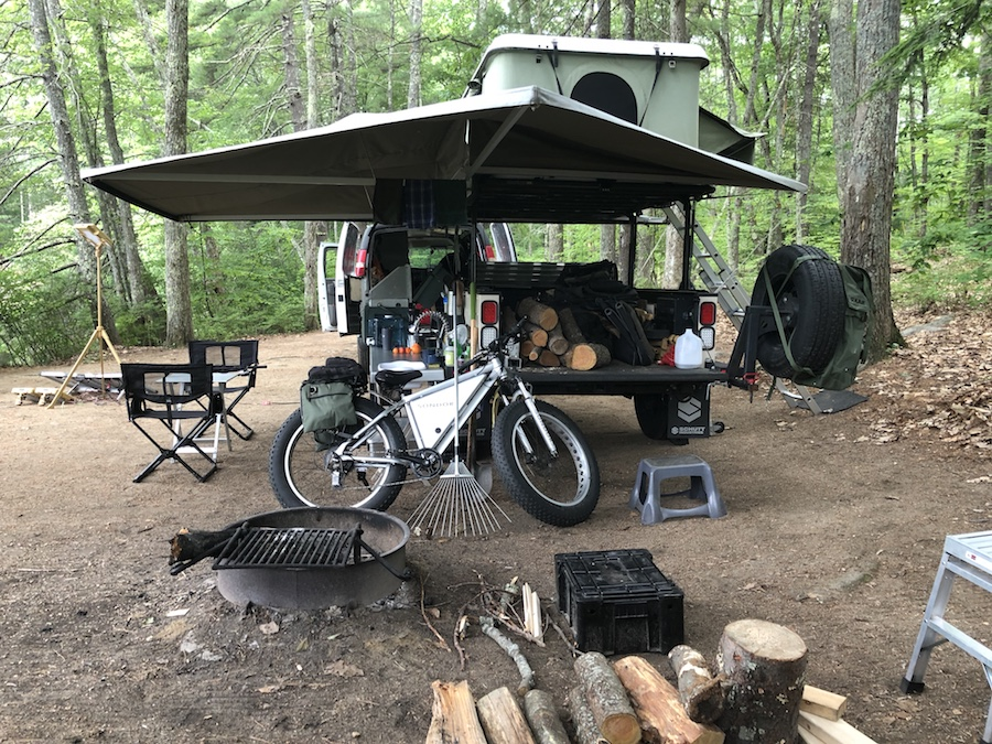 Adventure rig showing 3-sided awning and rooftop tent attached to off-road trailer.