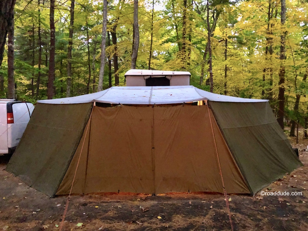 Adventure trailer with awning, sidewalls and rooftop tent set up as cold weather camp