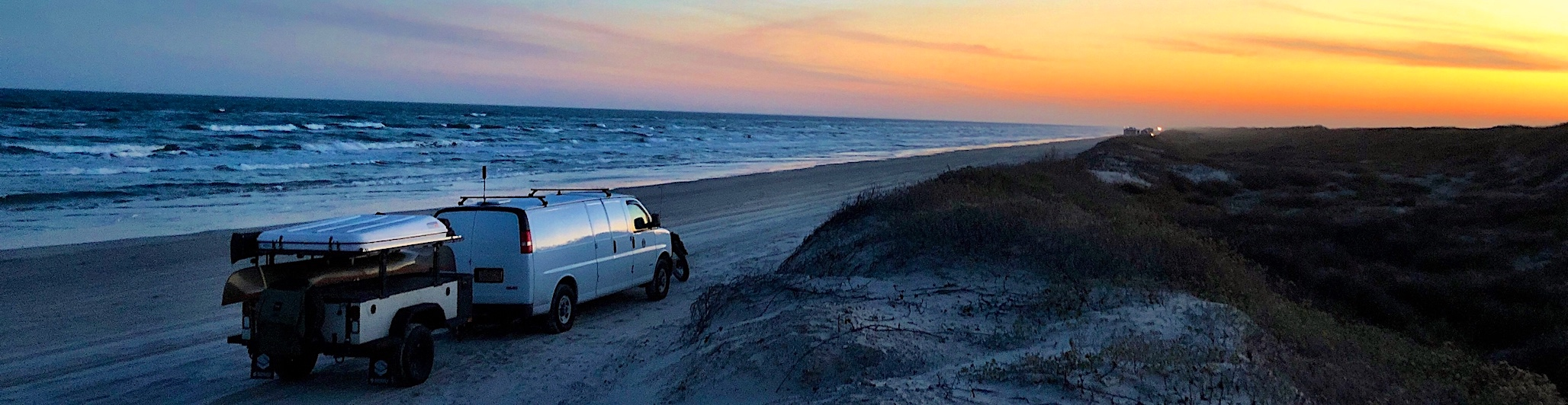Roadude - On the Road In America: Van and camping trailer on Gulf of Mexico beach at sunset