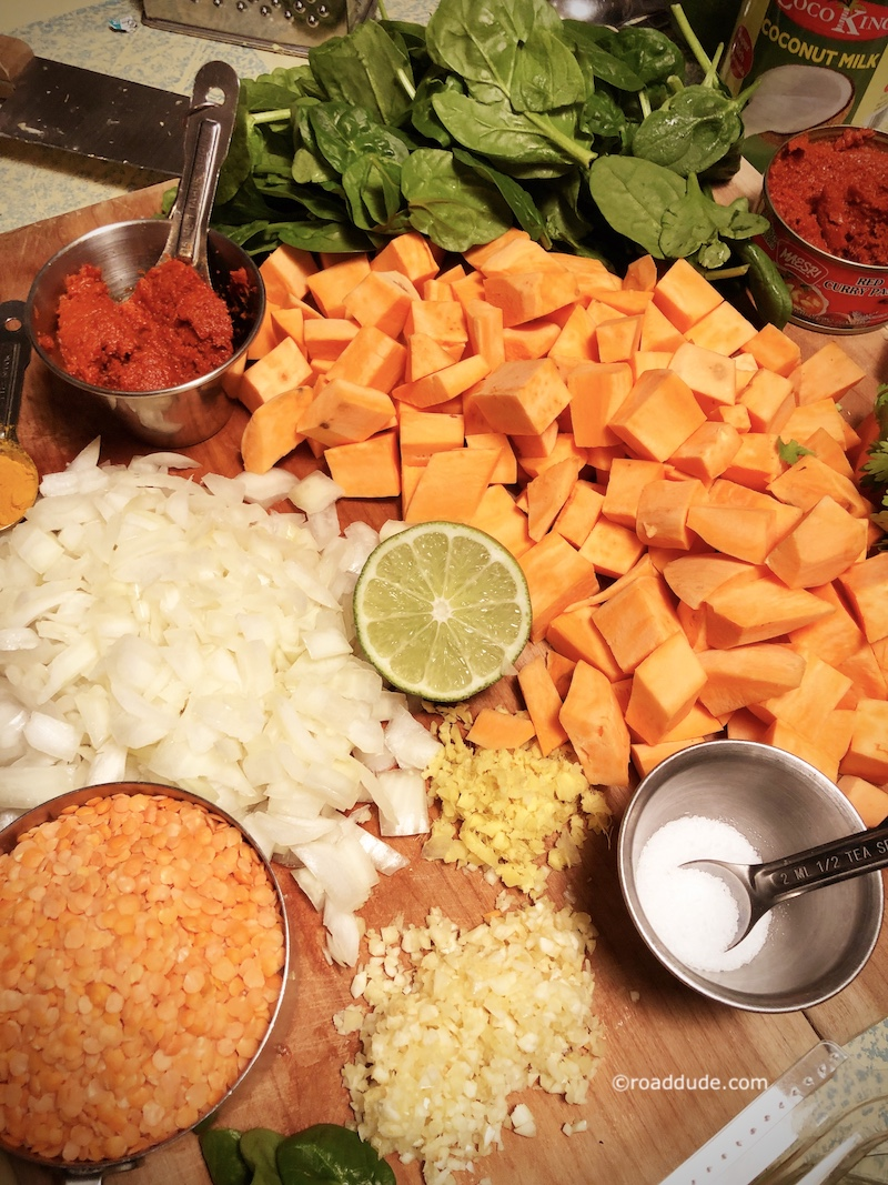 Ingredients cut up for Red Curry Lentils with Sweet Potatoes and Spinach on rice