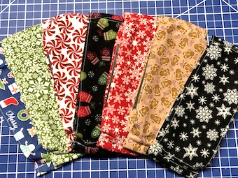 image of several face masks with holiday patterns